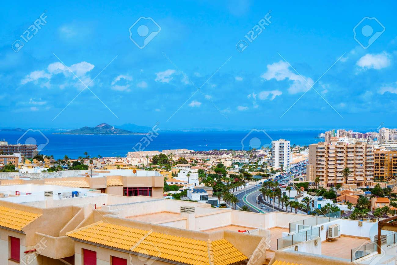 a view over La Manga del Mar Menor, in Murcia, Spain, with the Mar Menor lagoon and the Isla del Baron island on the left - 173345510
