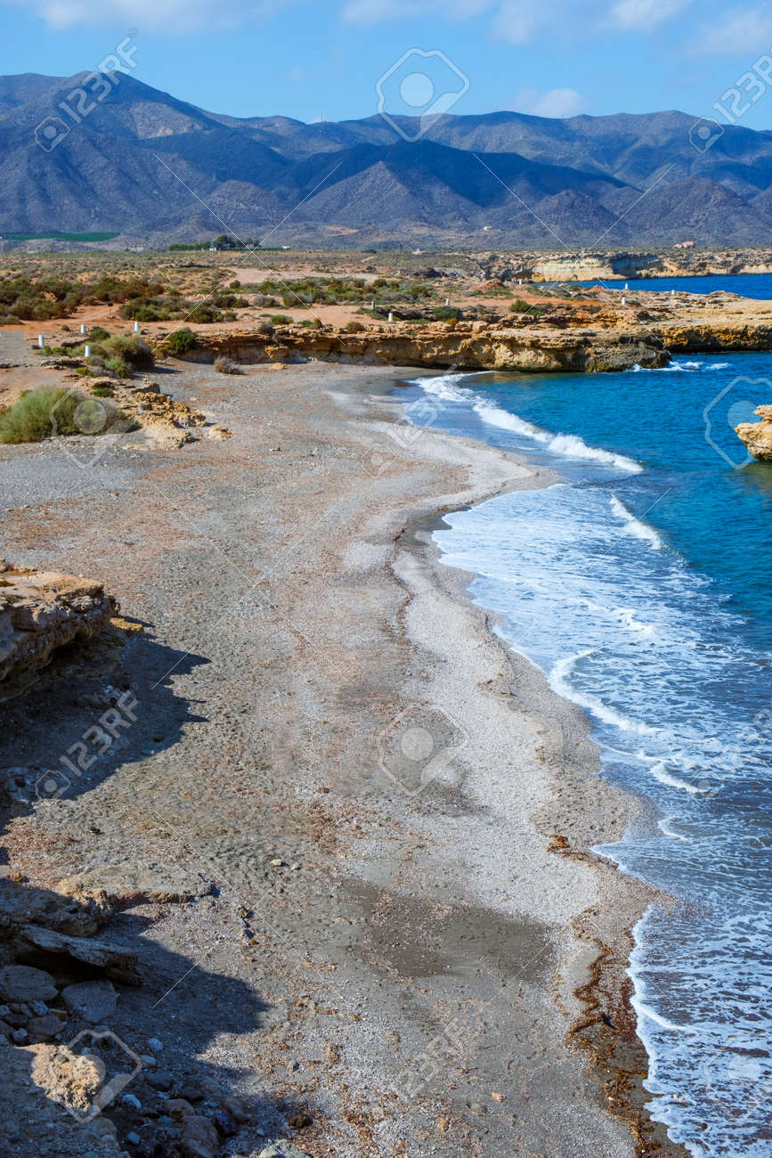 a view of La Galera beach, in Aguilas, in the Costa Calida coast, Region of Murcia, Spain, highlighting the Calnegre mountain range in the background - 173404365