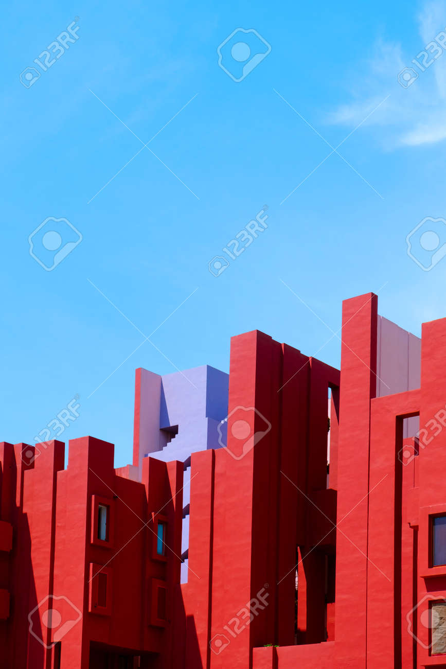 Calpe, Spain - August 2, 2021: The picturesque La Muralla Roja building, in Calpe, Spain, an apartment building designed by Ricardo Bofill and built in 1972, against the blue sky - 173480952