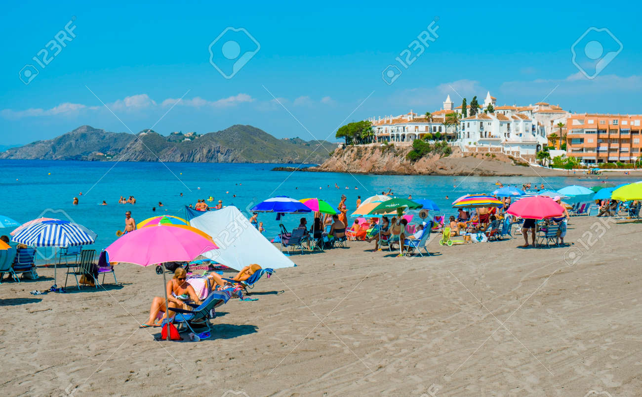 Aguilas, Spain - July 27, 2021: Some people are enjoying the beach in Calabardina Beach, in Aguilas, in the Costa Calida coast, Murcia, Spain - 173480959