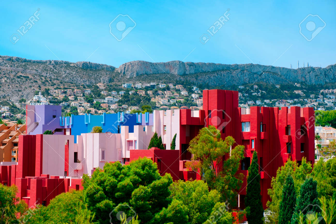 Calpe, Spain - August 2, 2021: A view of the picturesque and colorful La Muralla Roja building, in Calpe, Spain, an apartment building designed by Ricardo Bofill and built in 1972 - 173480958
