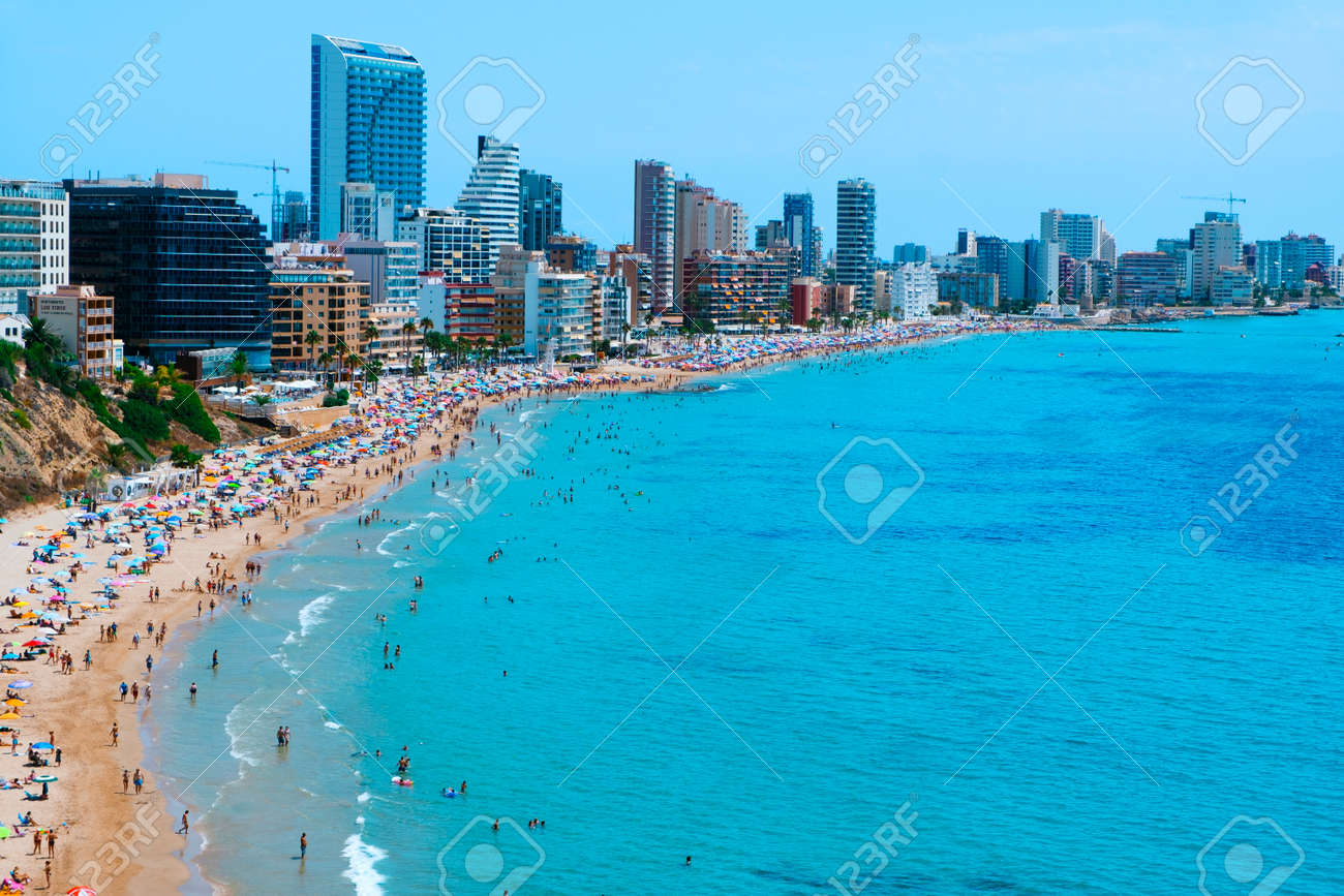 Calpe, Spain - August 2, 2021: A panoramic view of the main beach of Calpe, Valencia, an important summer tourist destination in Spain, highlighting its characteristic apartment towers - 173480960