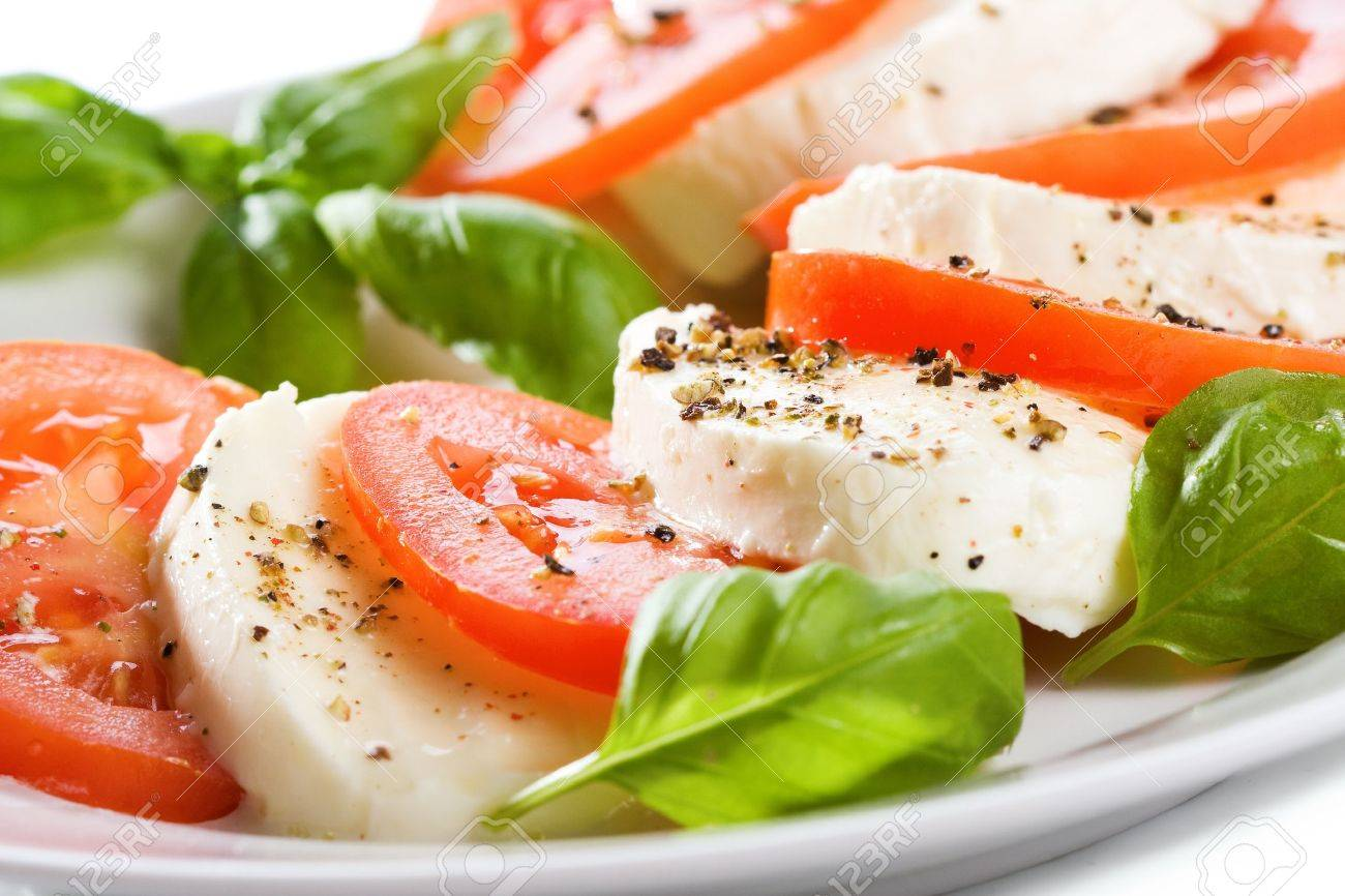 salad with mozzarella, tomatoes and basil - 11464880