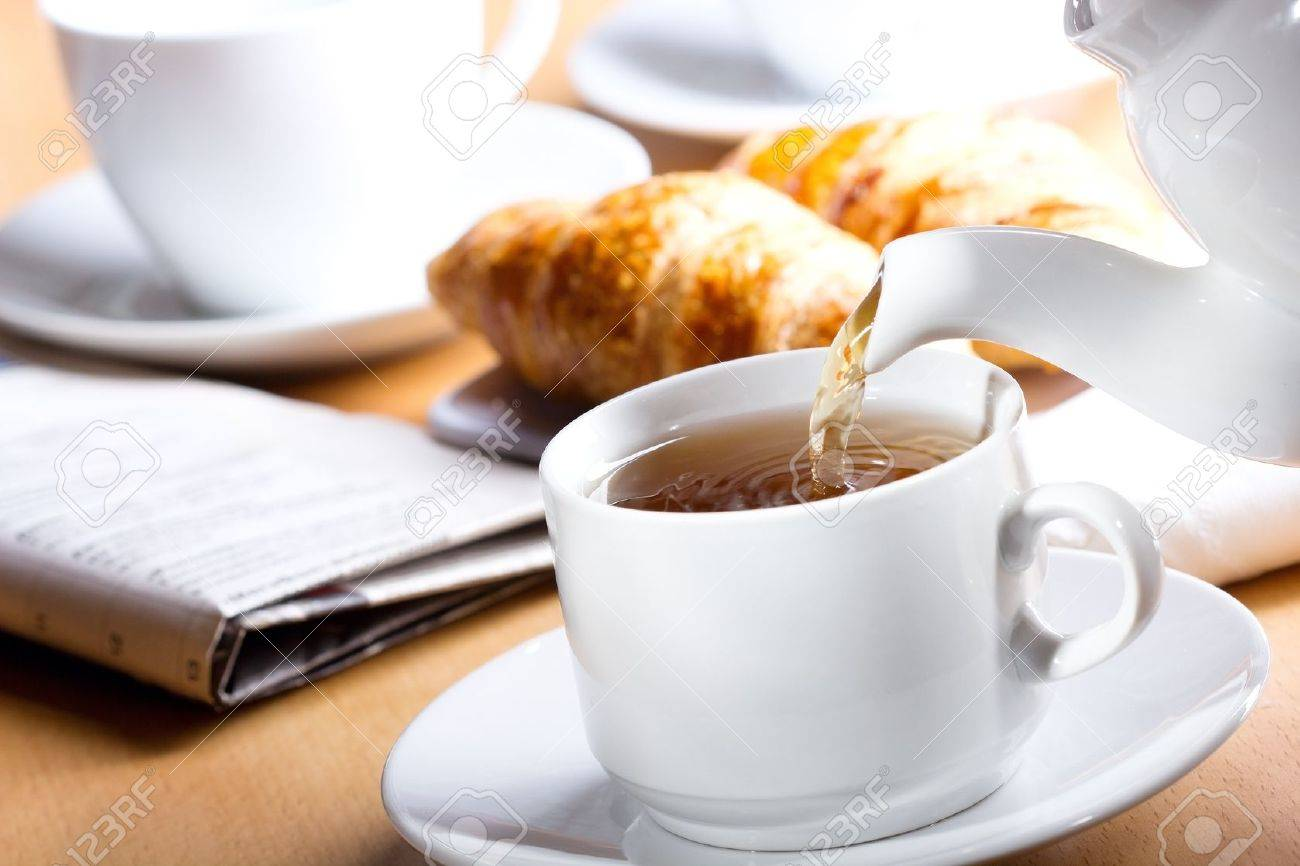 Pouring tea into cup of tea Stock Photo - 13496039