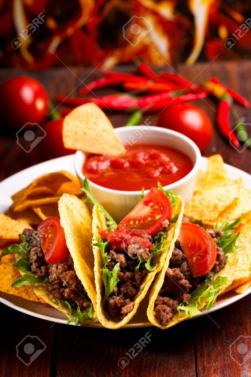 plate with taco, nachos chips and tomato dip Stock Photo - 15639051
