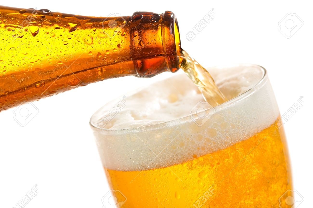 beer pouring into glass on a white background stock photo picture