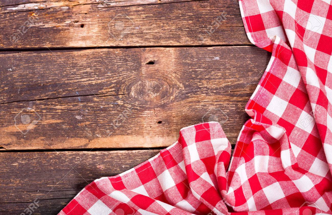 red tablecloth on old wooden table - 51757598