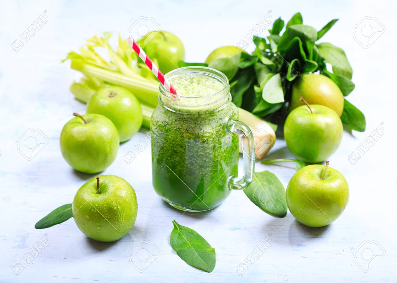 jar of green smoothie with apple, celery and spinach - 52593975