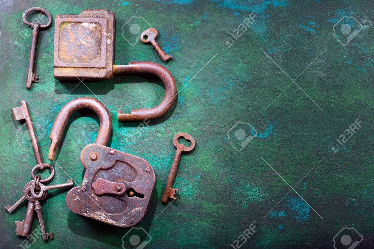 old locks and keys on rusty background stock photo picture and