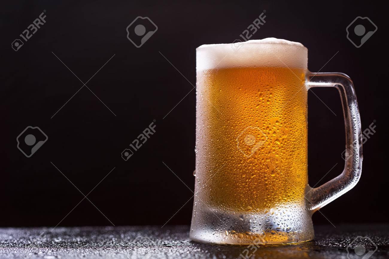 mug of beer on dark background - 59336730