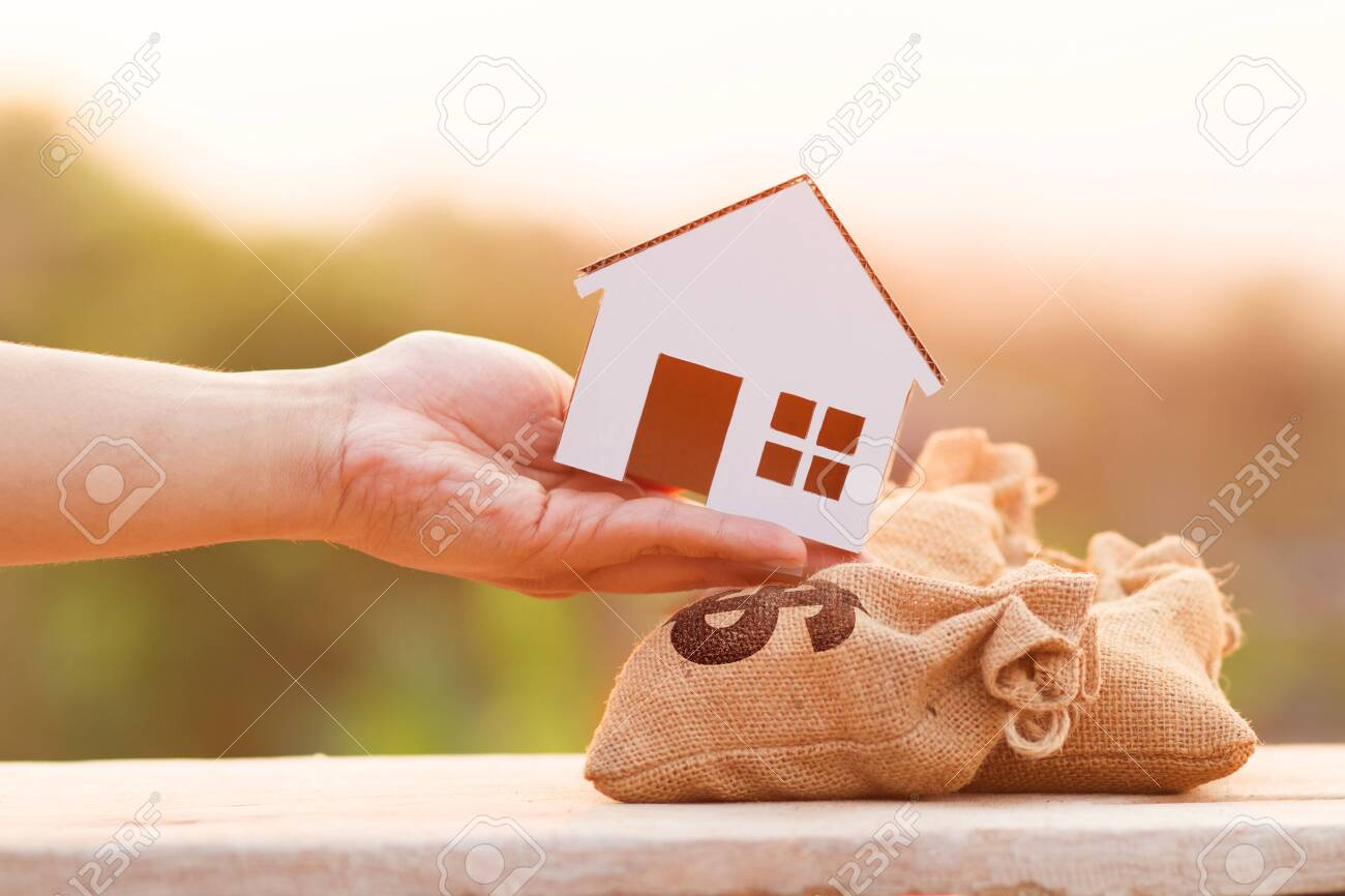 Buying a new house, saving and finance loan concept  Hand put