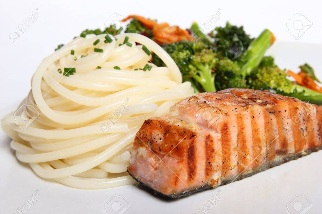 Grilled Salmon Served With Broccoli And Pasta Stock Photo 11237605