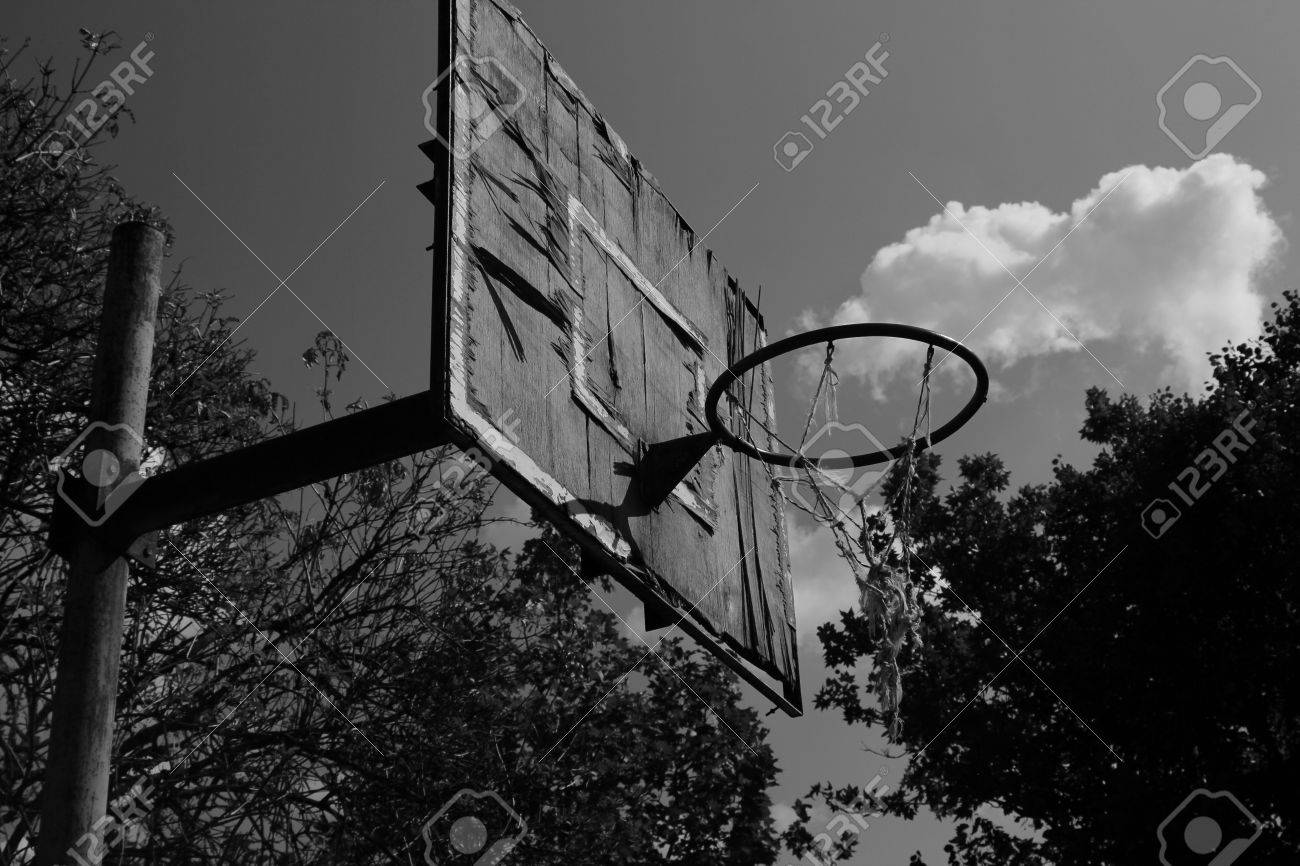 The old basketball playground black and white stock photo 77151432