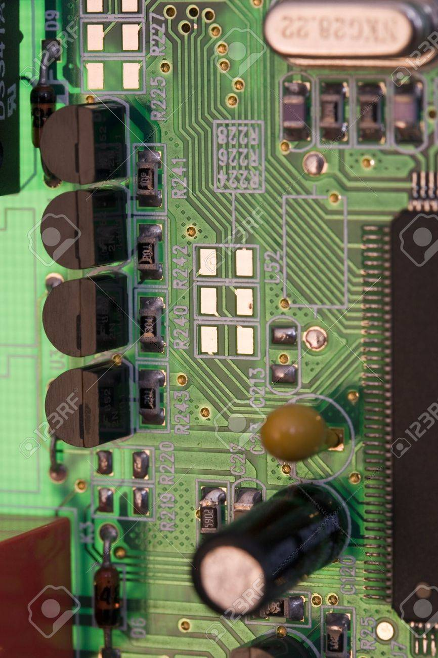 Green Pcb Board With Small Devices Like Transistors Or Resistors Circuit Stock Photo 4342398