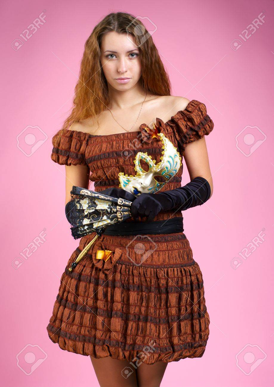 Beautiful young woman in evening dress with carnival mask Stock Photo - 8253924