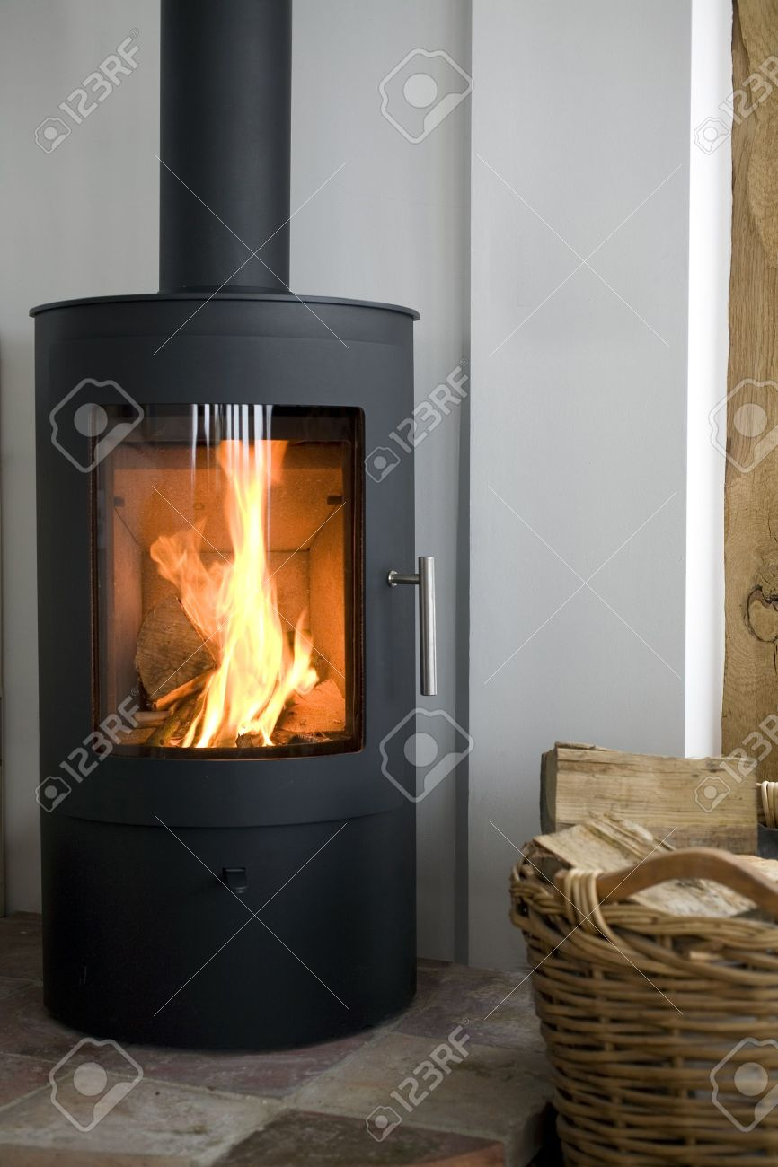 modern wood burning stove in modern interior stock photo picture