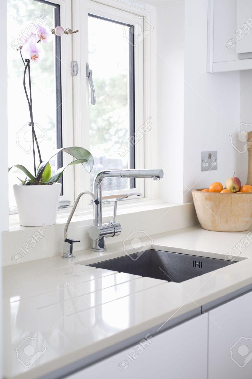 Modern Kitchen Sink And Tap Inset Into Stone / Quartz Worktop Stock ...