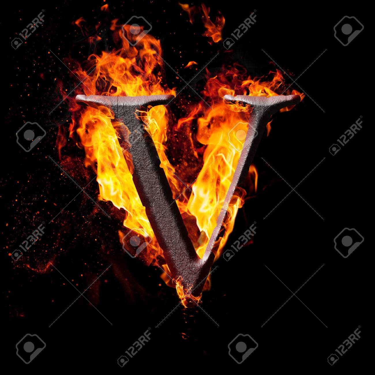 Letters And Symbols In Fire   Letter V. Stock Photo, Picture And