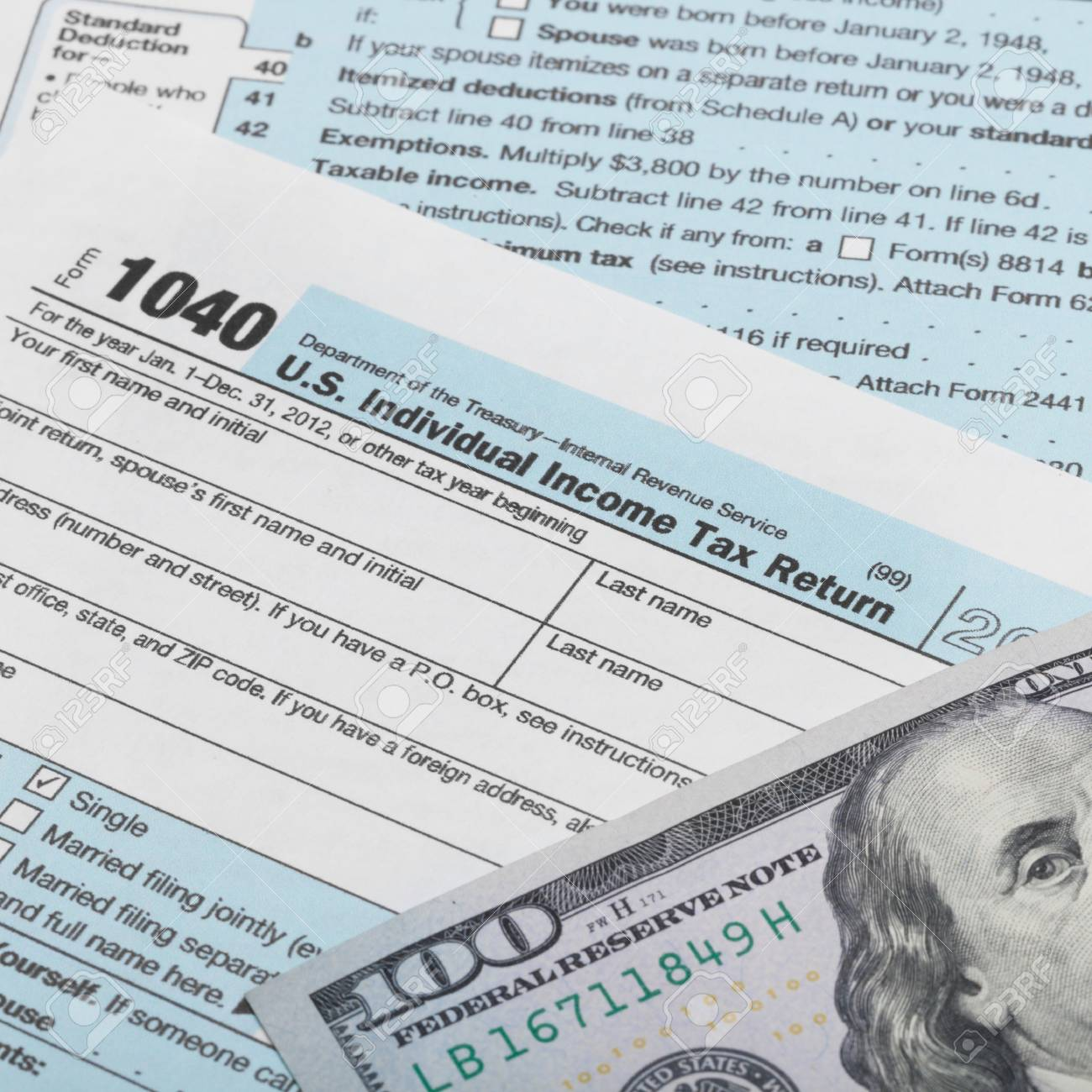 Us Tax Form 1040 With 100 Dollars Banknote Above It Stock Photo