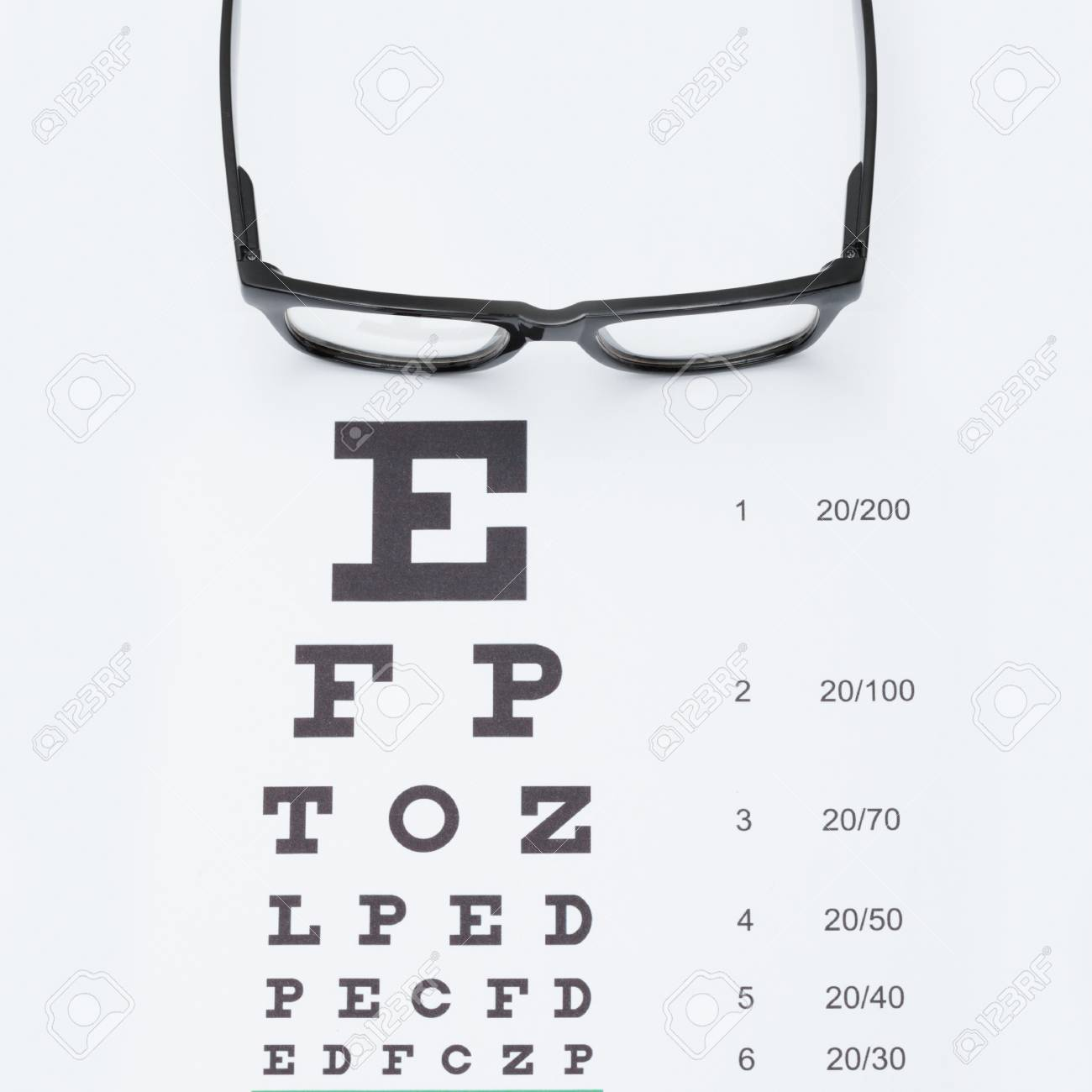 Eyesight test chart with glasses - studio shot - 1 to 1 ratio Stock Photo -