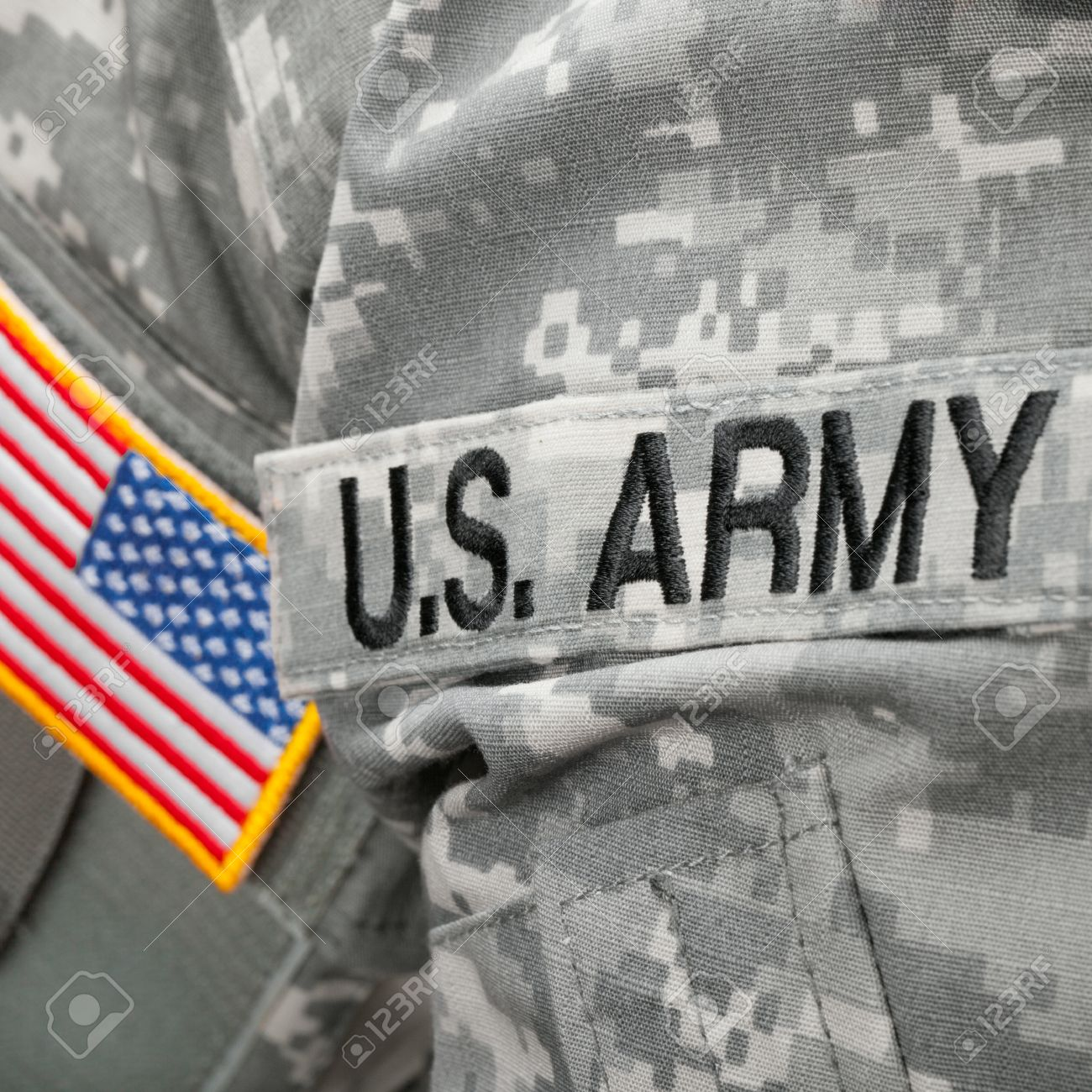 2c52cafdf8d4 Stock Photo - US Army and flag patch on military uniform - close up shot