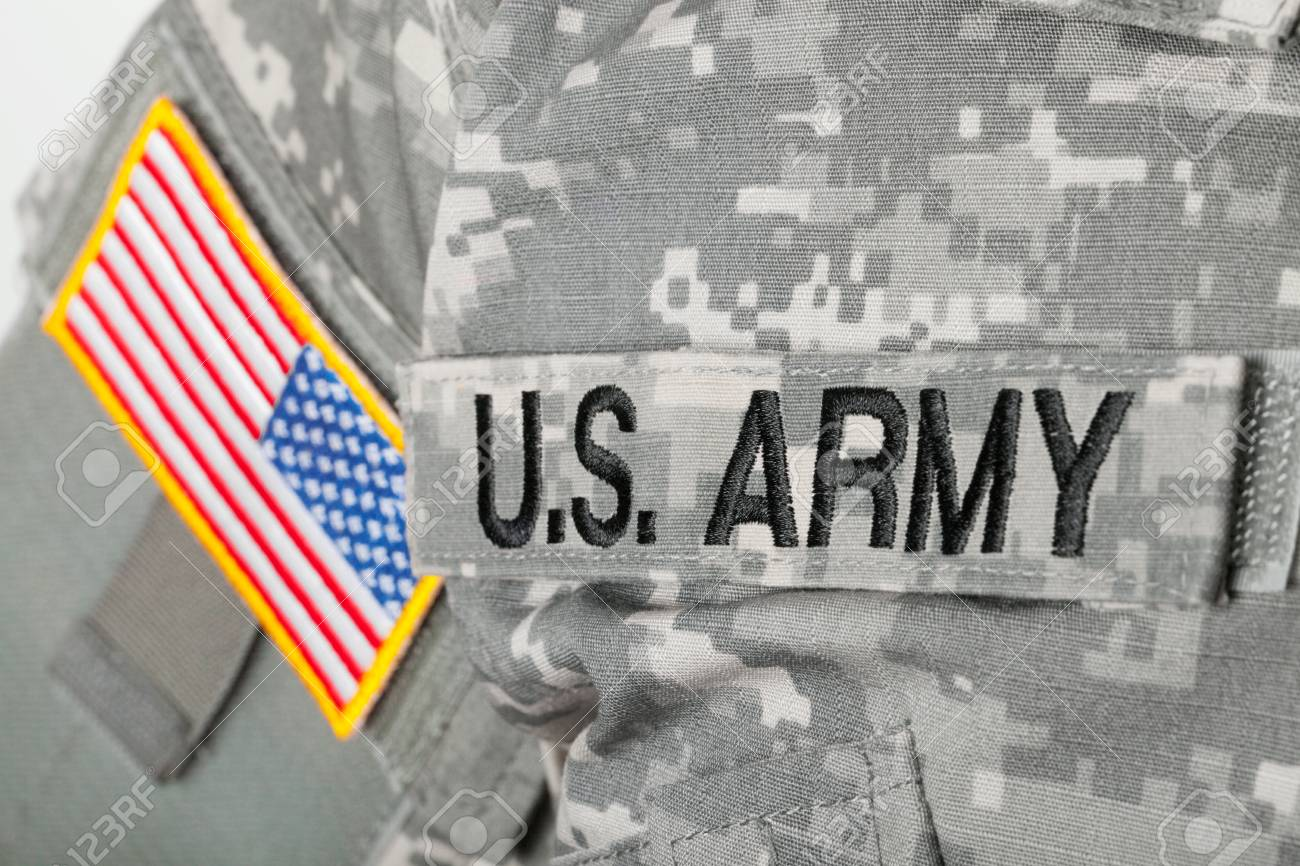 69957817043e Stock Photo - Studio shot of U.S. ARMY and USA flag patches on American  solders uniform