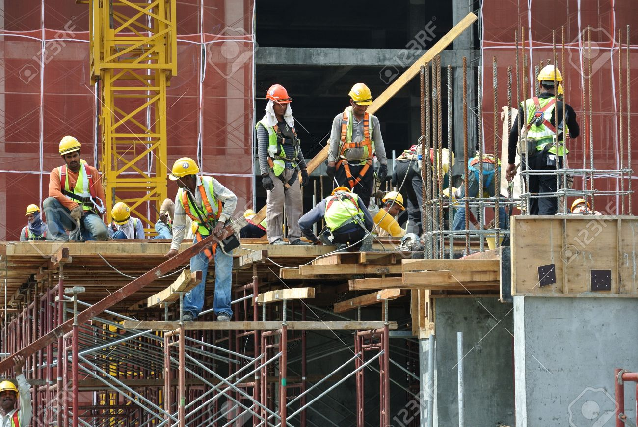 Construction workers wearing safety harness and adequate safety