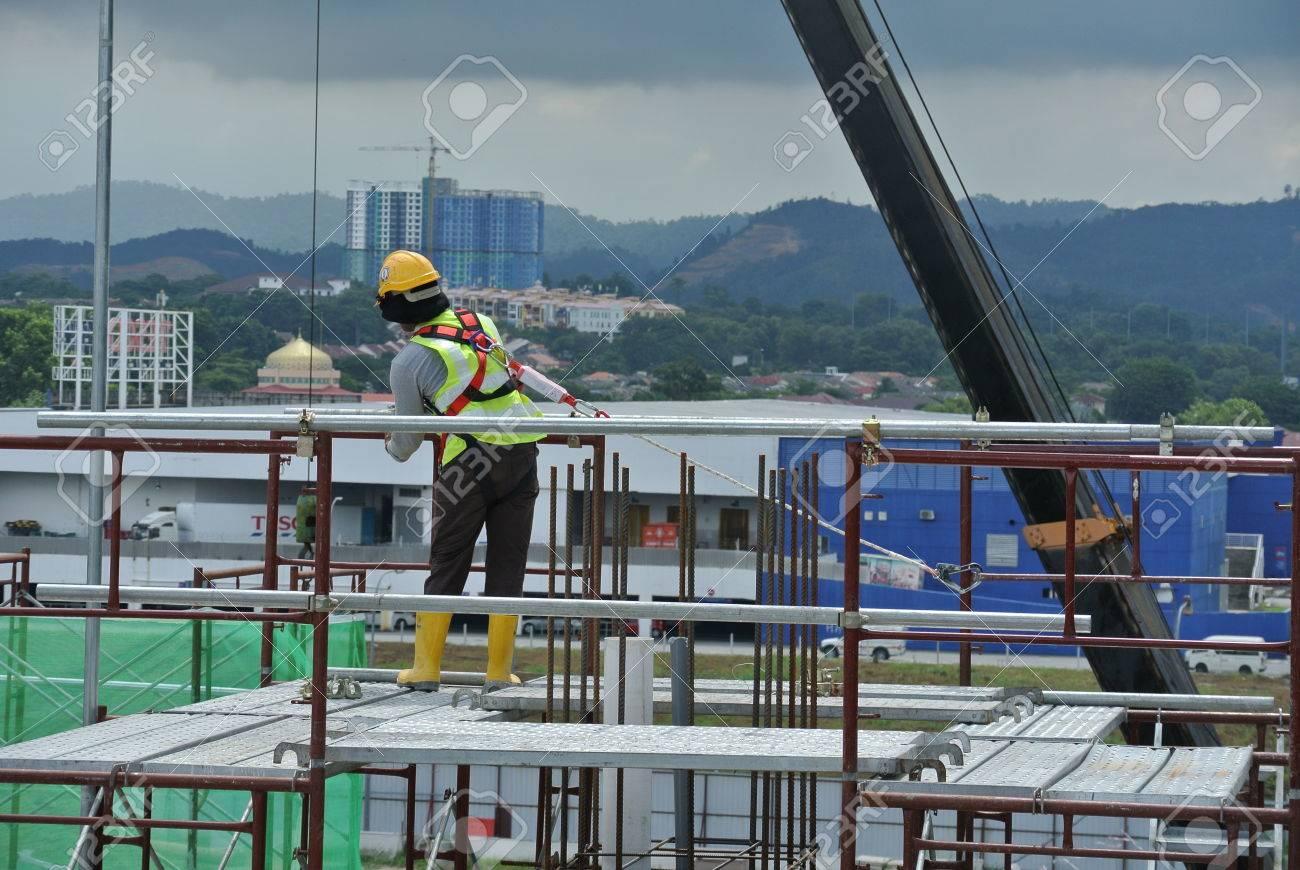 PERAK, MALAYSIA -JULY 18, 2016: Construction workers wearing