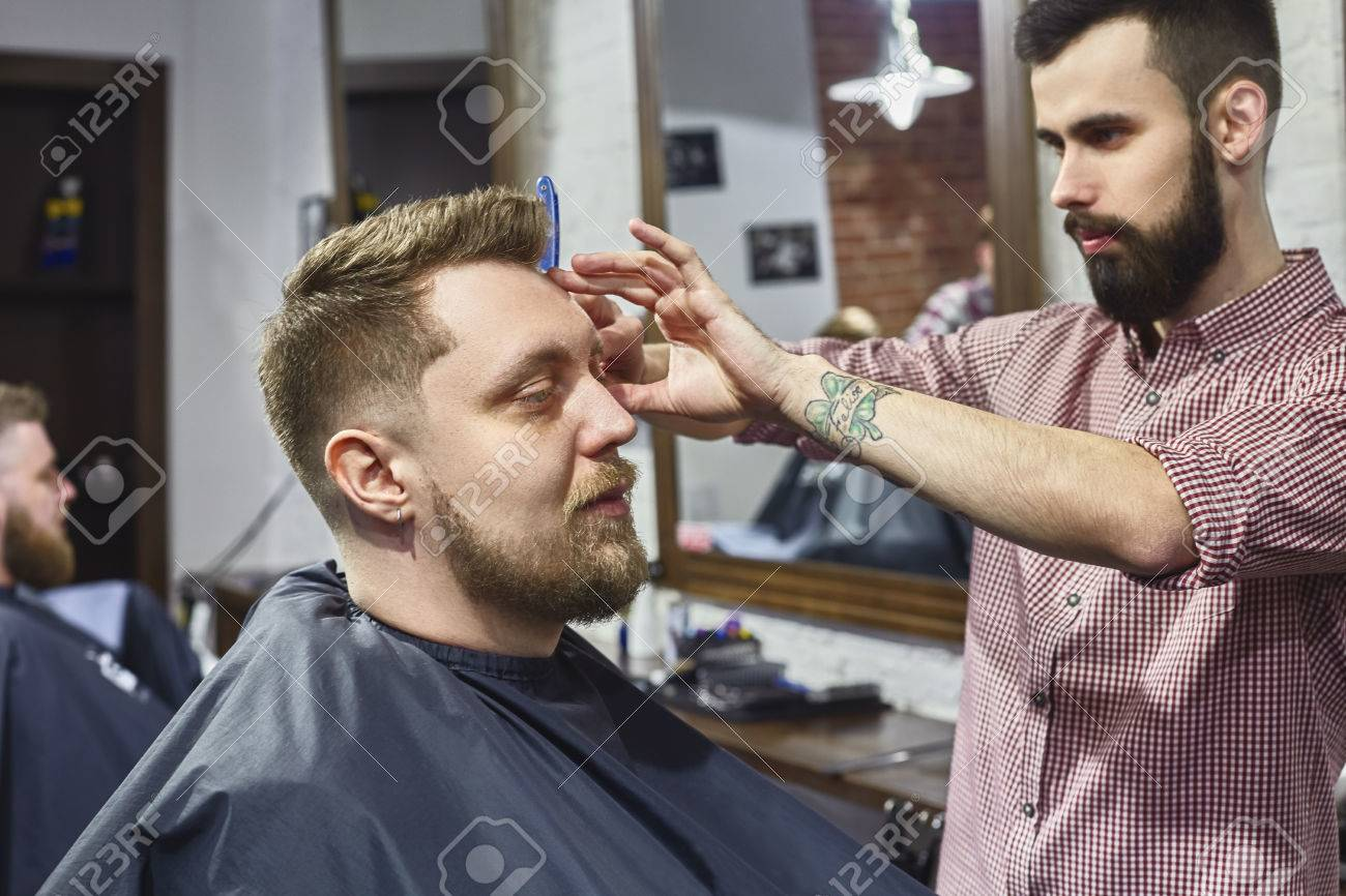 Mens Haircut In The Barber Shop The Work Of The Master Stock
