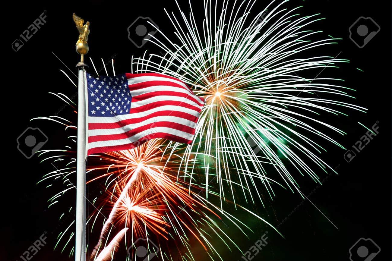 american flag with fireworks in background for celebrating stock photo 13379350