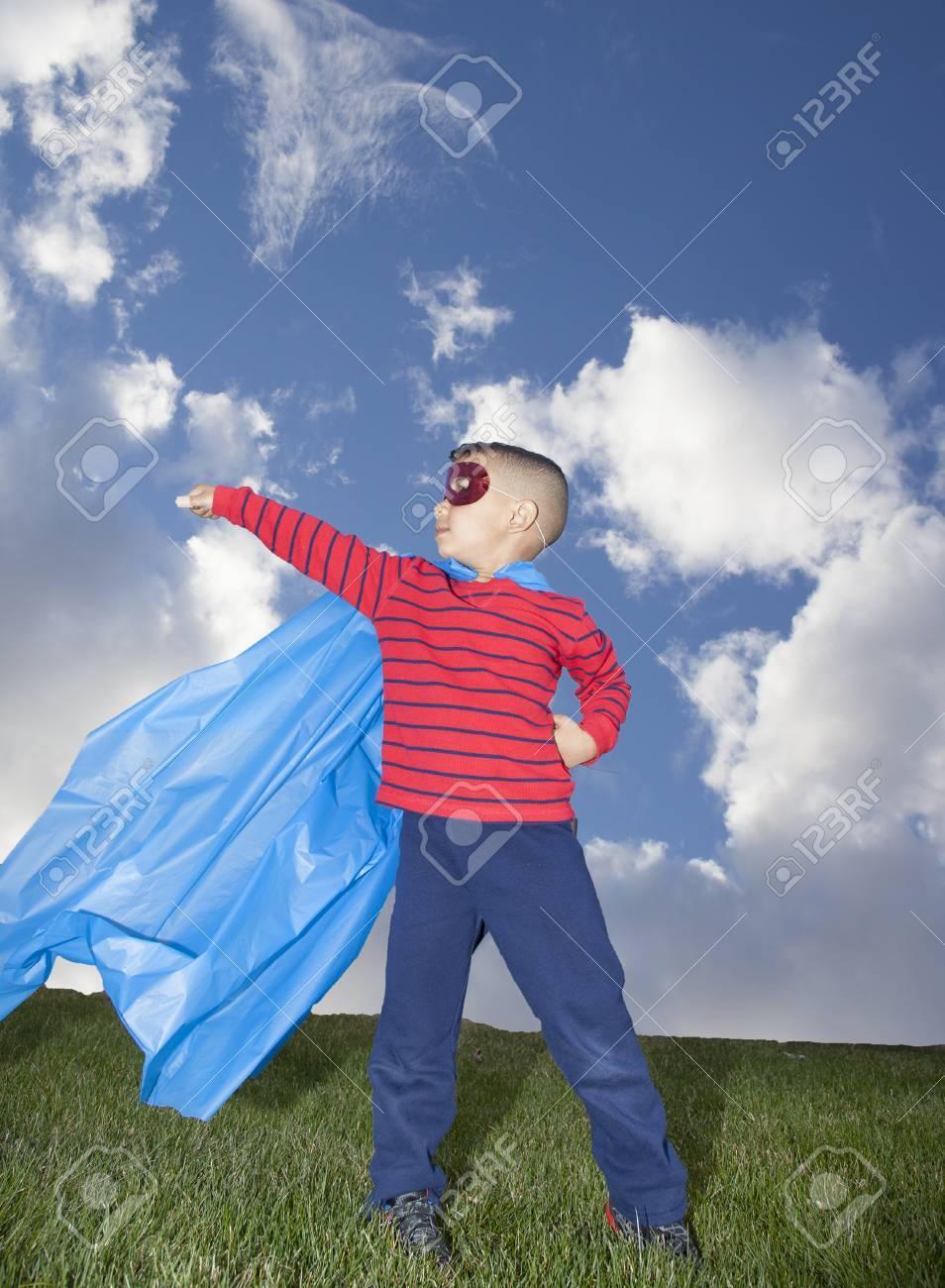 little boy superhero against blue sky - 39761882