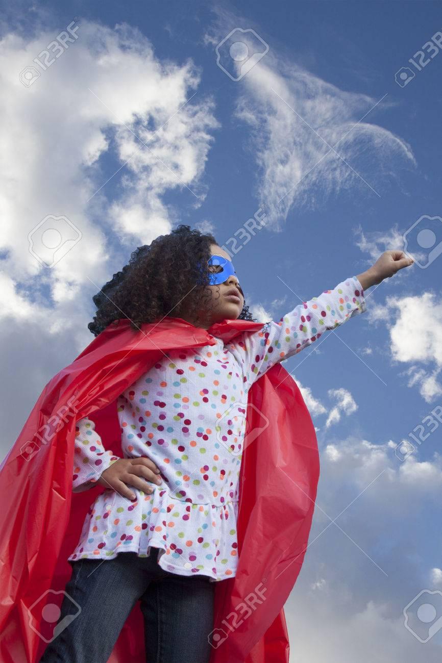 little girl superhero against blue sky - 39761916