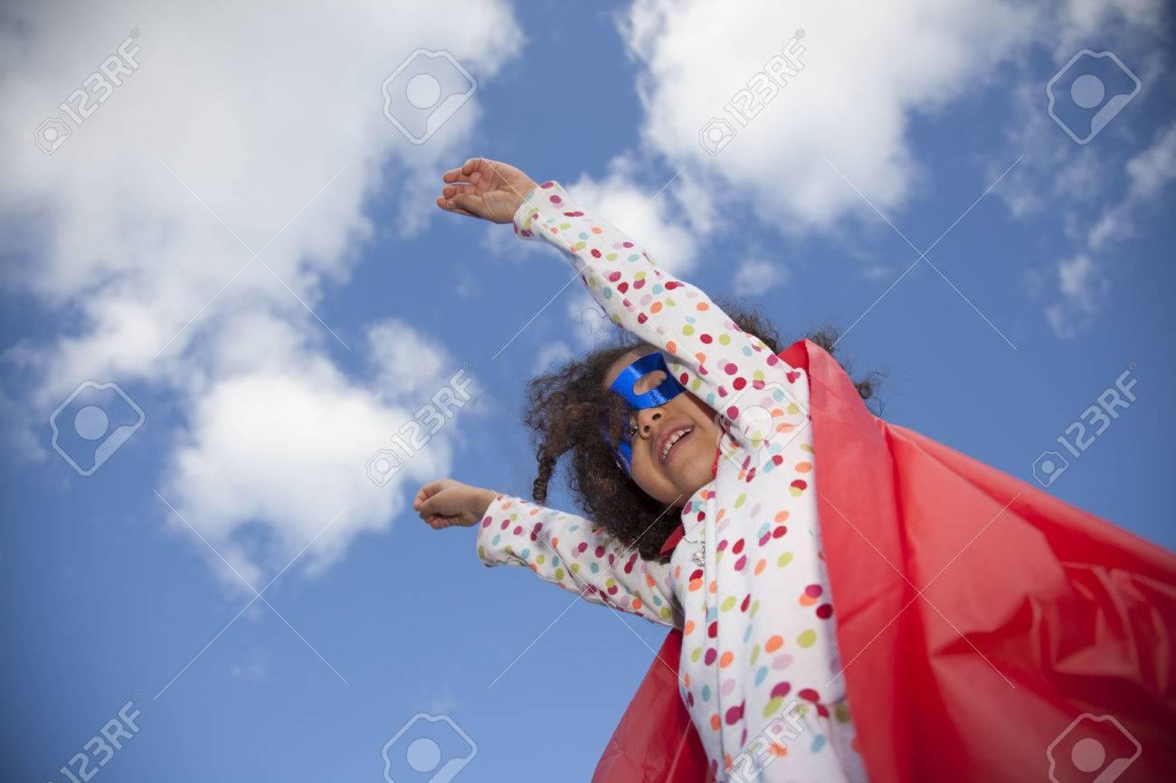 little girl superhero against blue sky - 39761928