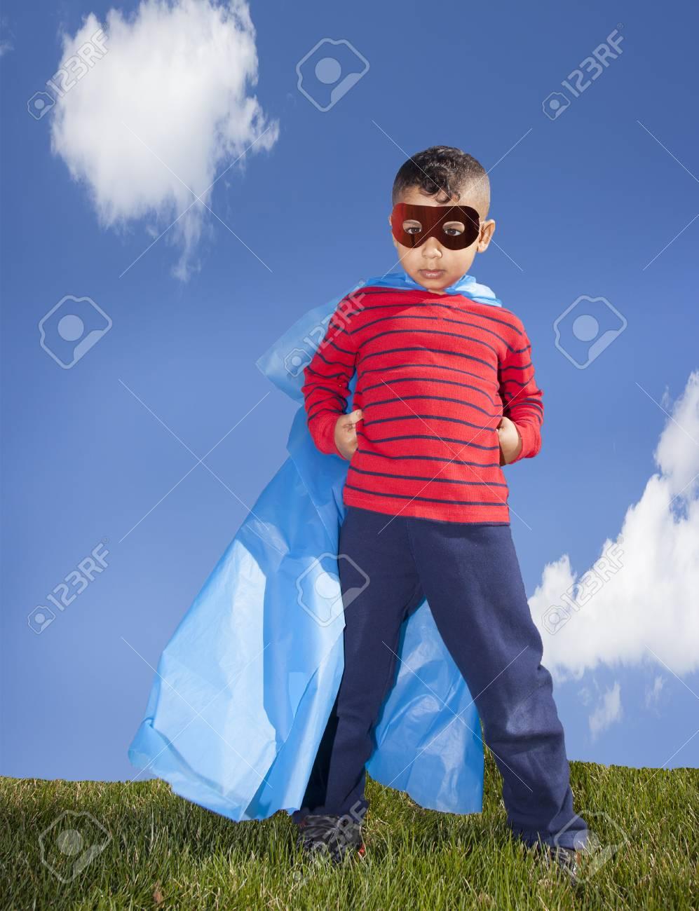 little boy superhero against blue sky - 39762084