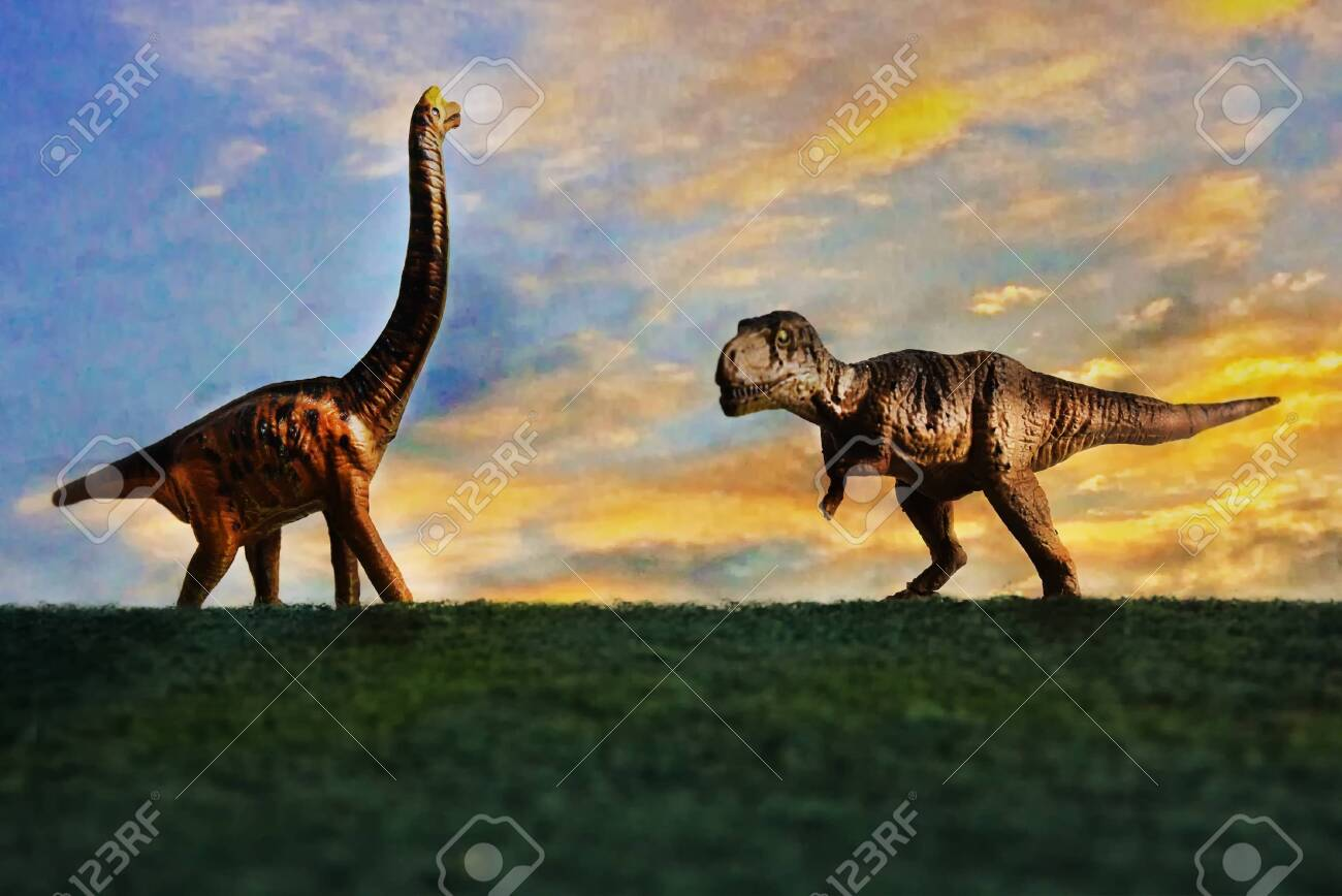 Tyrannosaurus rex or t-rex infront colorful sky and foliage in background - 145088970