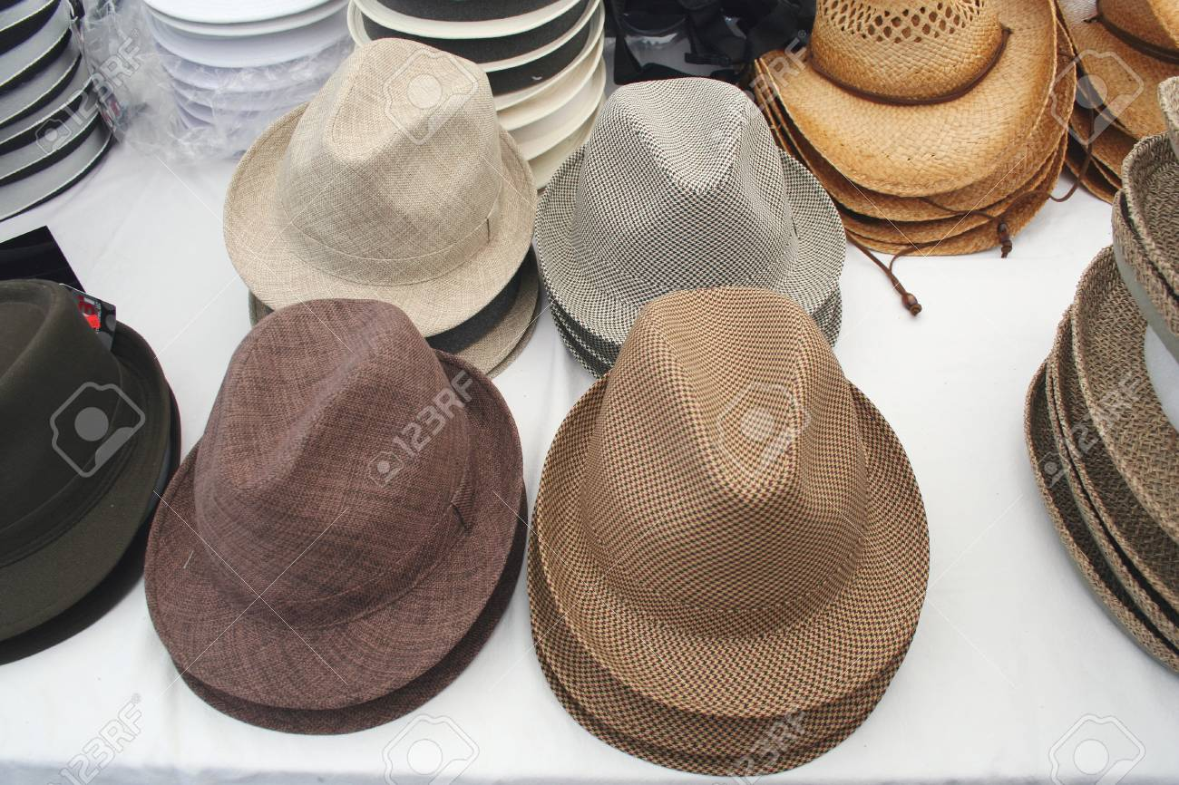 cc9bddb0e1 A bunch of mens hats stacked on a table for sale Stock Photo - 1455564