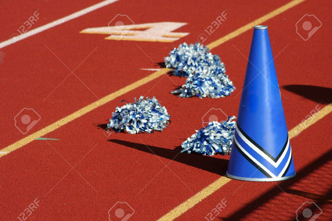 Cheerleader pom poms and megaphone at a football game Stock Photo - 1877537
