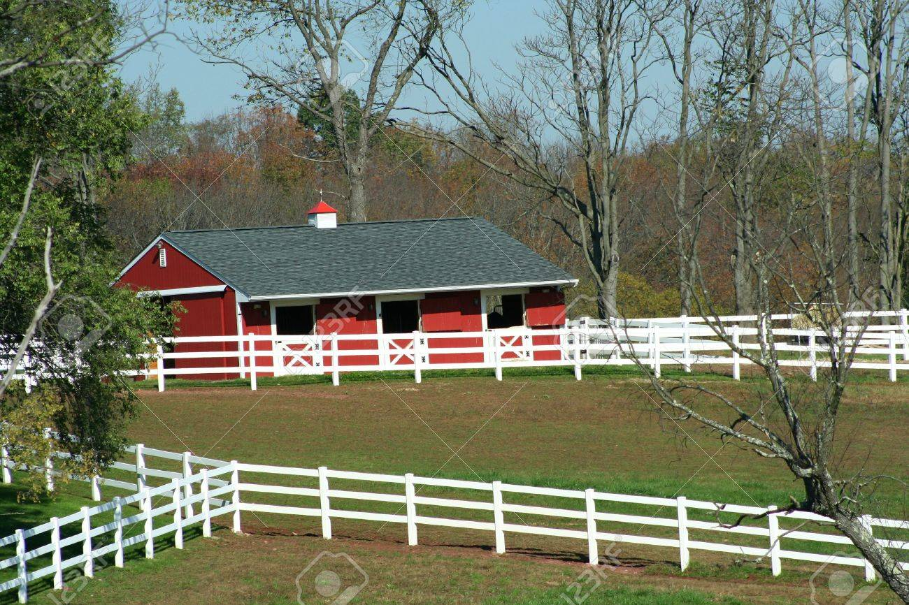 A Red Barn and white horse fence Stock Photo - 2026716