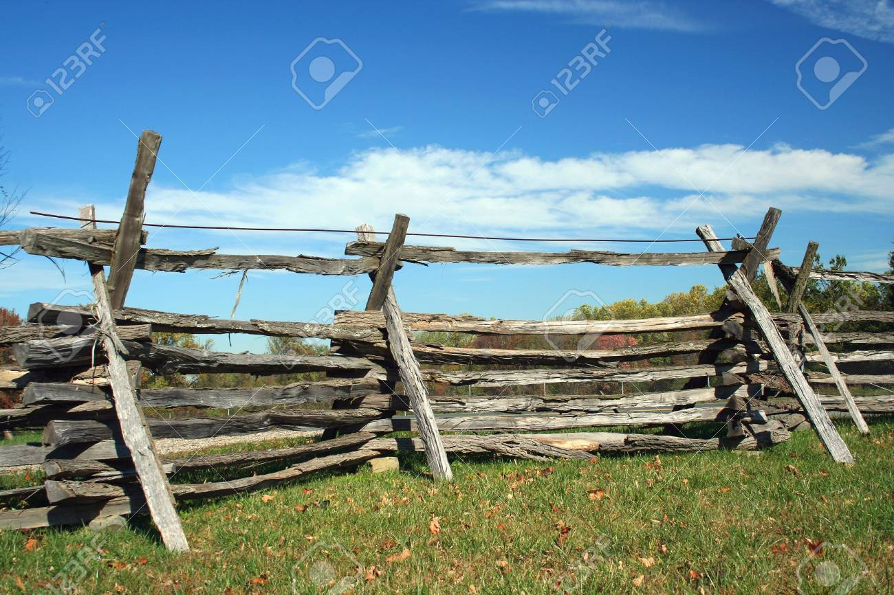 A Stacked wood fence against blue sky Stock Photo - 2026748