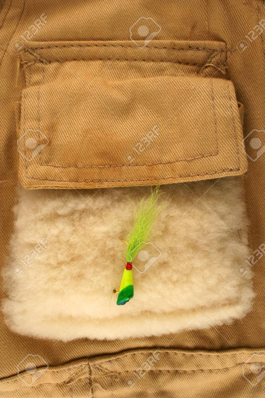 Fishing lure on a vest pocket Stock Photo - 2309730
