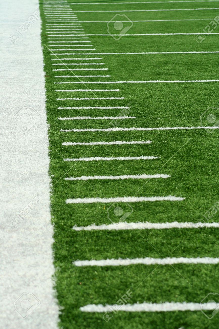 White Football Yard Markers on astro turf Stock Photo - 3453491