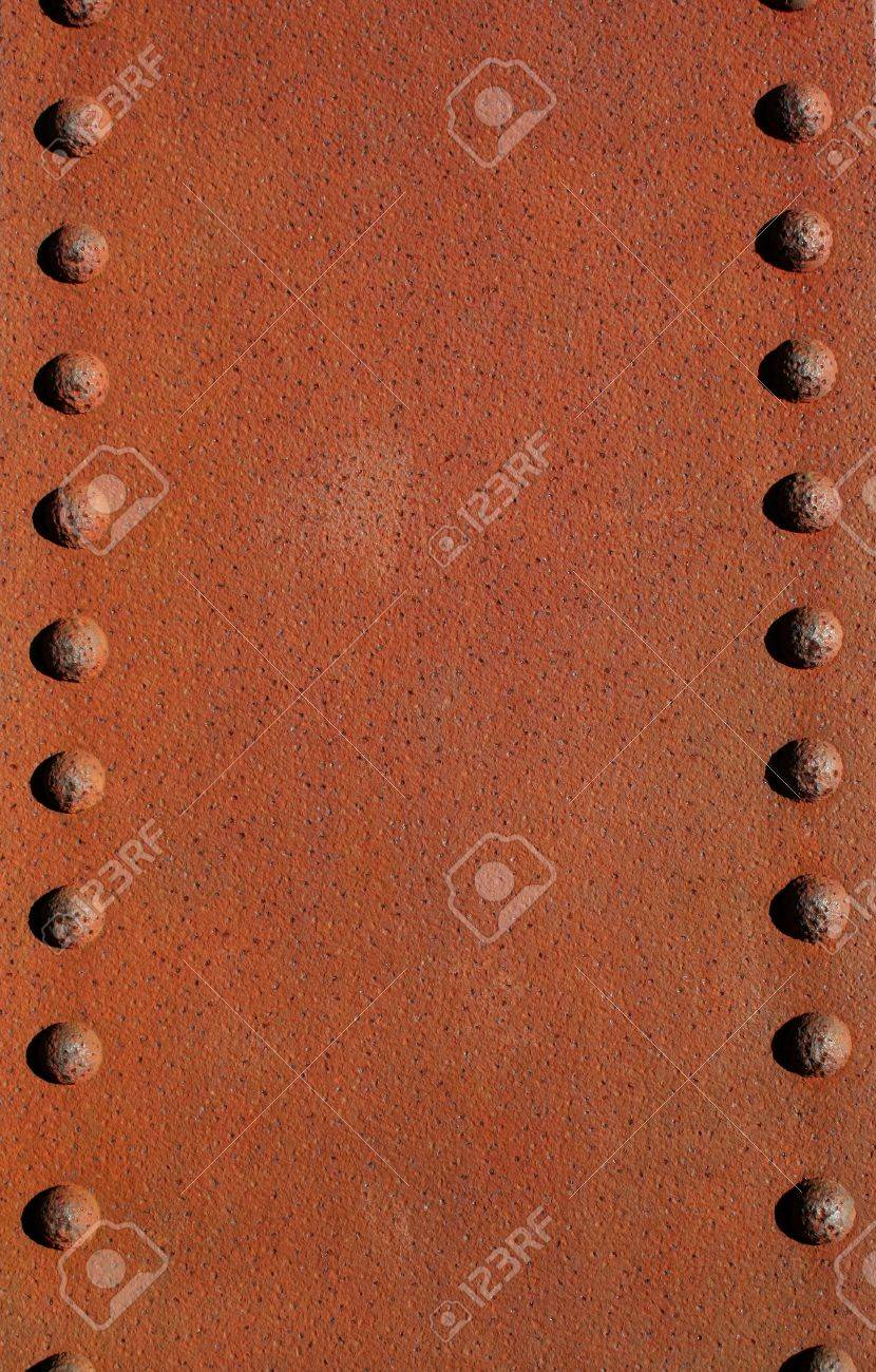 A Rusty metal plate with rivets Stock Photo - 8421226
