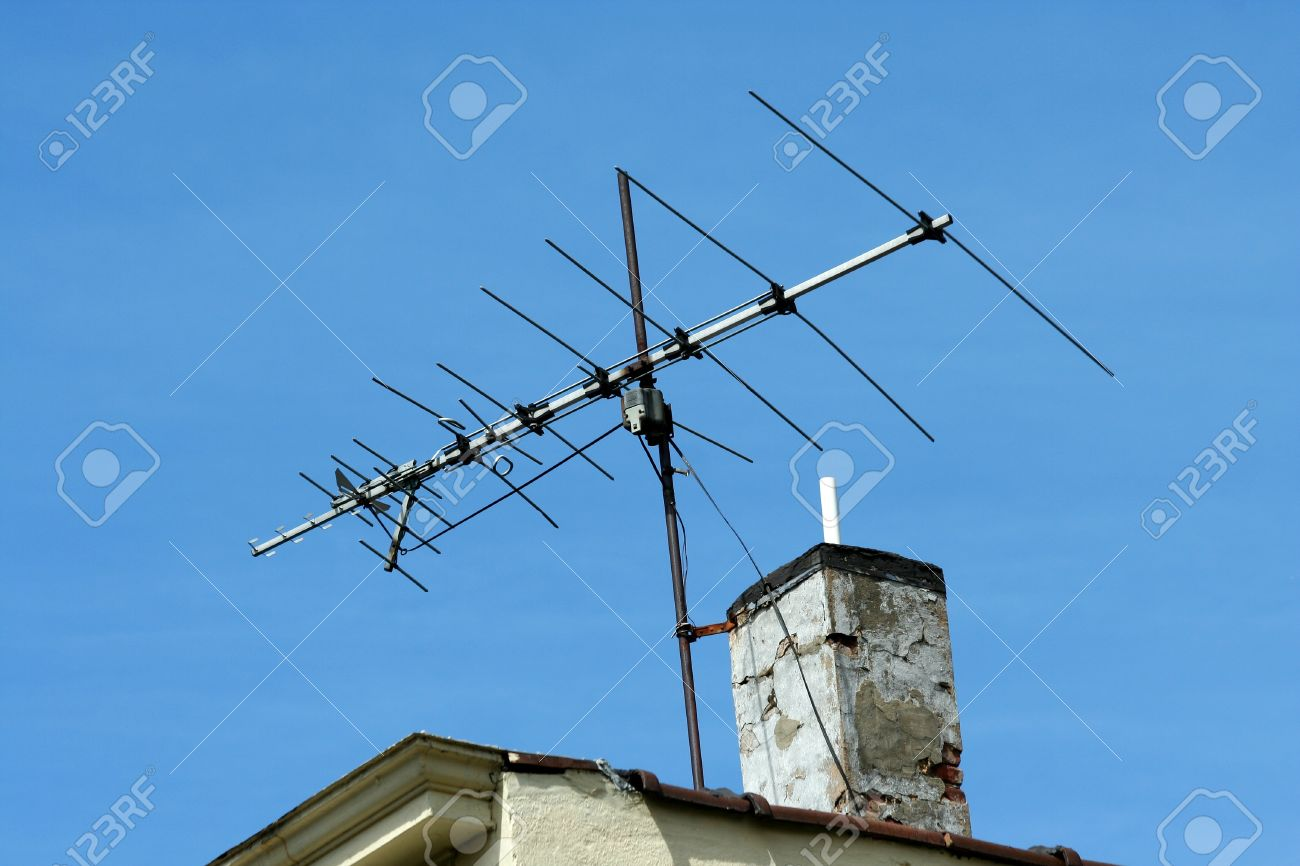 TV Antenna On The Roof Of A Building Stock Photo   13558420