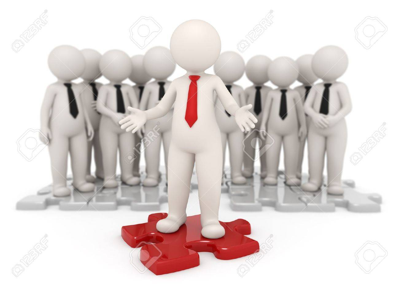 Successful business leader standing on a red puzzle piece in front of his team - Isolated Stock Photo - 10865404