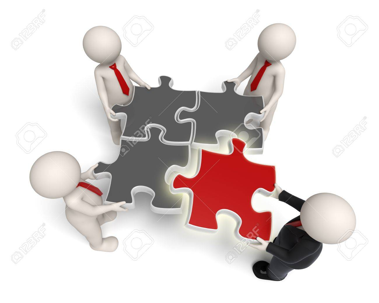 3d rendered white business people assembling puzzle pieces, the red one is glowing. Stock Photo - 11688325