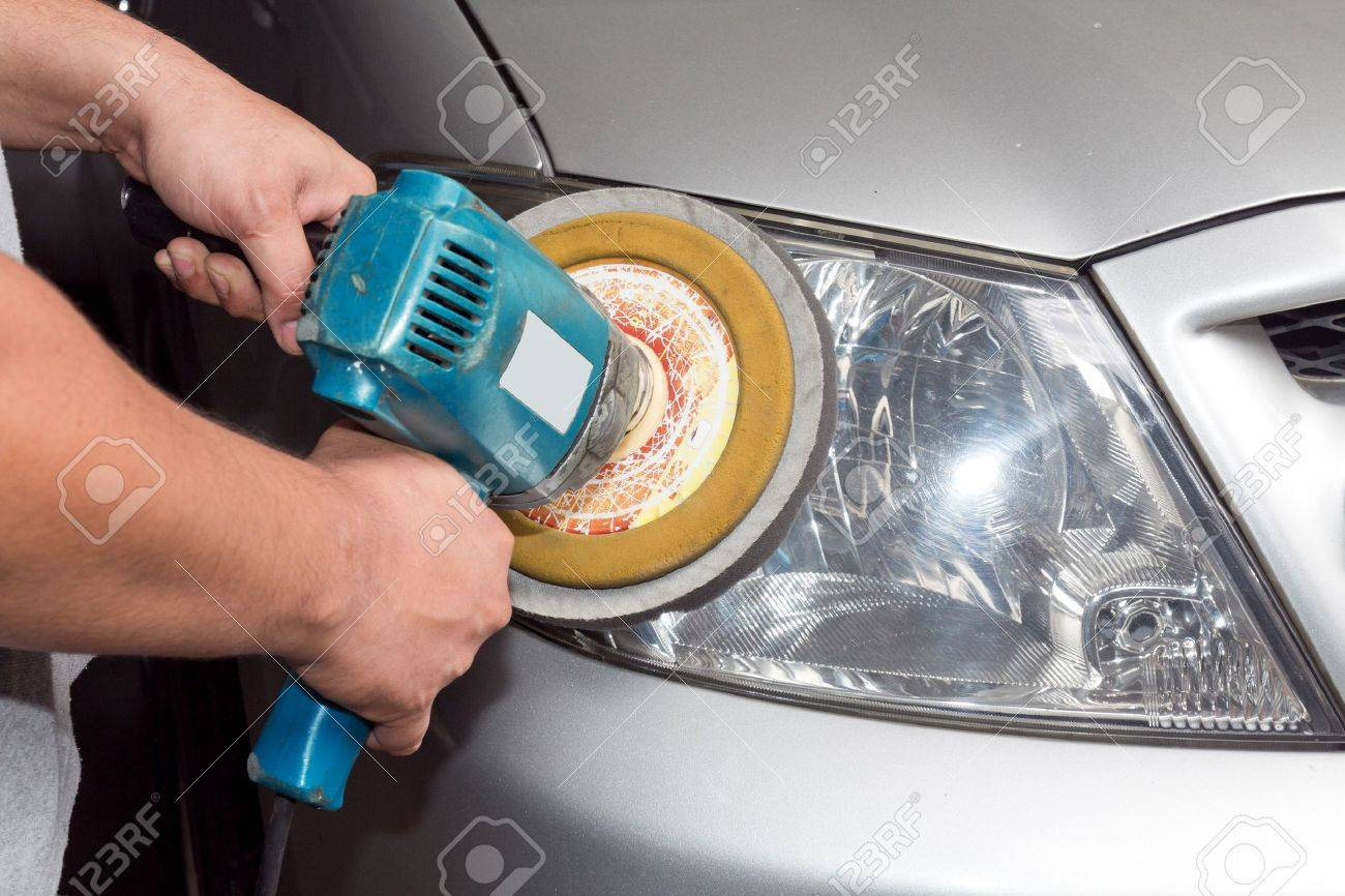Car headlights with power buffer machine at service station Stock Photo - 11930236