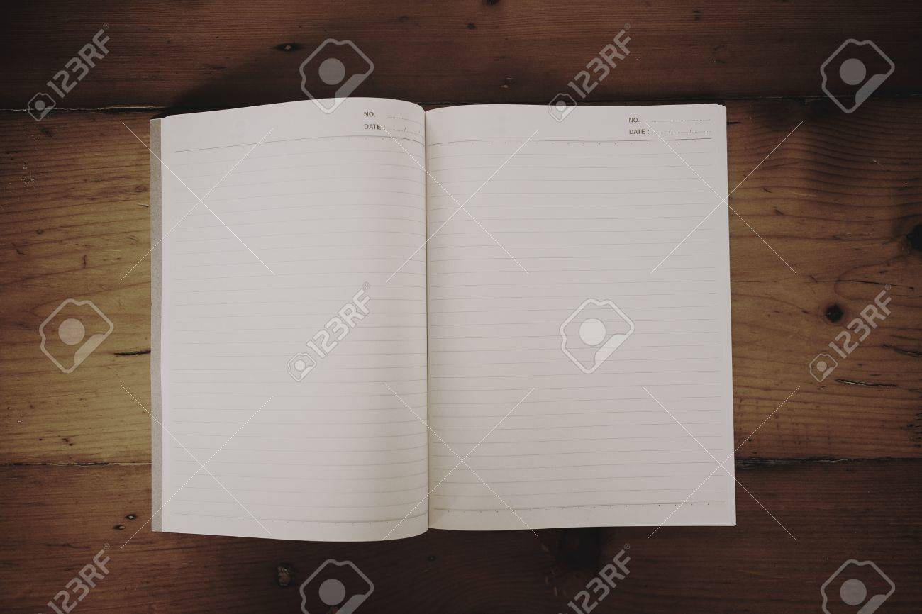 Notebook on table, Uneven diffuse grunge lighting version design component Stock Photo - 20273098
