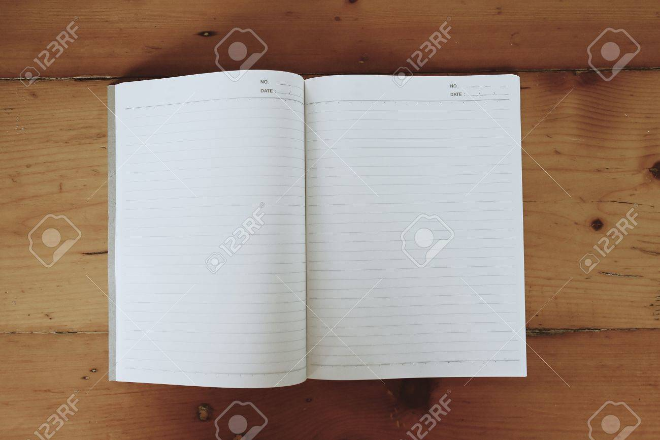 Notebook paper on desk Stock Photo - 20273558
