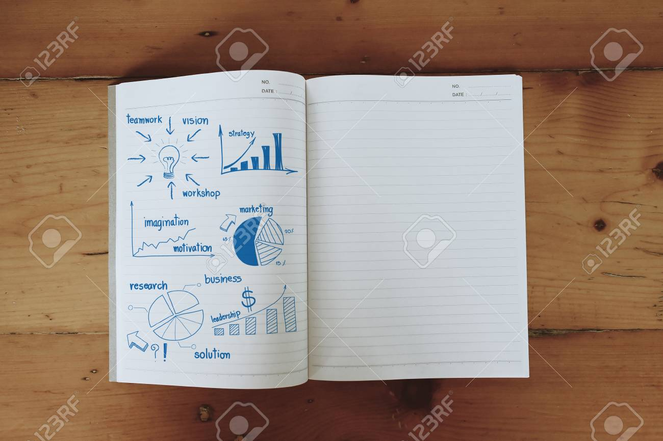 Business concept and graph drawing on book, With drawing business plan strategy plan concept idea Stock Photo - 20273561