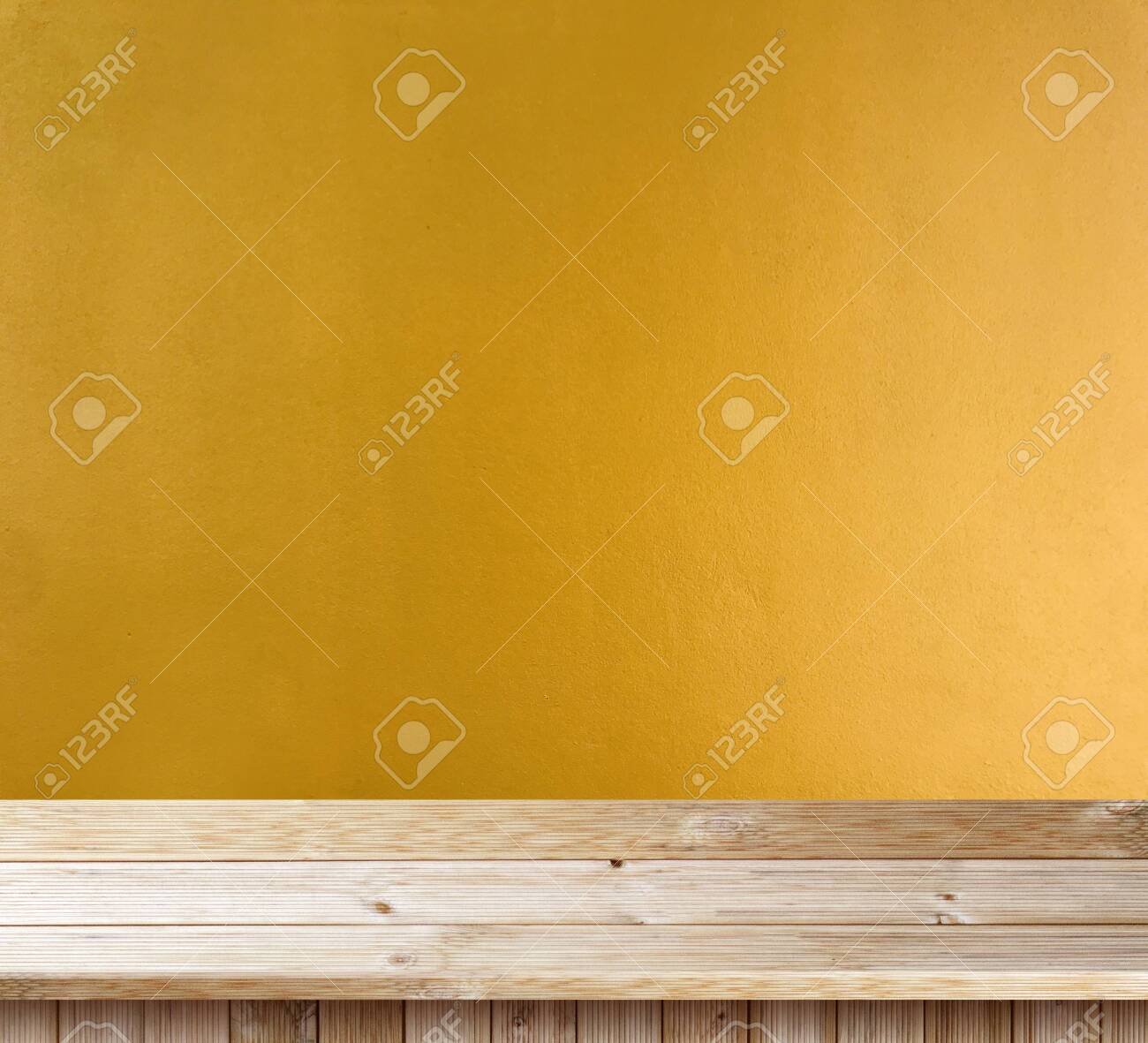 Table top wooden deck on yellow wall texture - 124800837
